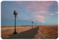 Solar Power (Craig Jewell Photography) Tags: arid desert dry greatvictoriadesert minecamp mounteba prominenthill solar southaustraliadesert iso800 f45 ¹⁄₁₀₀sec canon canoneos5dmarkii ef1635mmf28liiusm copyright2016craigjewell 29°4228s135°3154e ‒⅓ev aperturepriority 20161206205307mg9465cr2 red orange clouds cloudy sunset dusk twilight martian moonscape gravel inhospitable barren stark sky open landscape nature geography geographical horizon australia outback wilderness