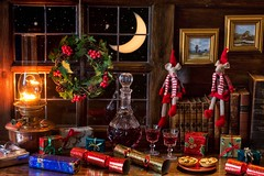 Christmas Enchantment (memoryweaver) Tags: indoor tabletop stilllife solstice yule crackers presents warmtones kerosene lantern lamp paraffin oillamp night window stars moon mincepies memoryweaver wine cutglass decanter mice christmas