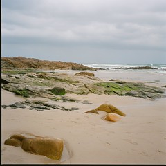 Low tide, cold day (davidgarciadorado) Tags: 120film kodakektar100 rolleiflex planar tlr sea beach sand rocks clouds galicia spain