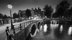 Keizersgracht Amsterdam (Clea Romeo) Tags: keizersgracht amsterdam canal water bridge city urban architechture blackandwhite light trail lamp sunset