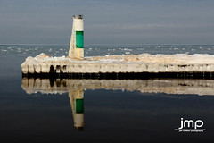 South Haven Lighthouse North Pier (Jeff Meeker) Tags: lakemichigan westmichigan winter winterwonderland weathered winterlife ice splash sparkle reflection reflections allthingsmichigan absolutemichigan artistic adventure slippery bluesky canon canont4i canondslr canon650d colorful clouds cloudsstormssunsetssunrises cold coldwater daylight day dangerousseas exploremichigan explore groupswithexperience interesting interestingness january 2017 lakeeffect michigan michigangottaluvit midwest michiganisamazing michiganlighthouses nature naturespaintbrush outdoorbeauty outdoorphotography outdoorphotographer outdoorphotos puremichigan photographersofwestmichigan peaceful quality southwestmichigan snow sunlight sunset stjosephmichigan stjoseph southhavenlighthouse southhaven southhavenpier thisisourmichigan themichigangallery theworldoutdoors vibrant texture newyearsadventures
