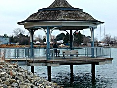 """We must accept finite disappointment, but never lose infinite hope.""  - Martin Luther King, Jr. (Trinimusic2008) Tags: trinimusic2008 judymeikle nature bench hbm january 2017 winter gazebo toronto to ontario canada outdoors rocks water marina sky"
