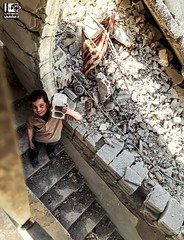 """From the rubble of my house I will build a new one"" (Take a look on Syria without propaganda) Tags: destruction destroy syria civilians civil children child childhood war rubble assad revolution regime rights russia eastren gouta generation spirit soul youth free freedom"