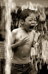 Hot or cold? (... Arjun) Tags: winter boy portrait bw 15fav hot cold water fountain monochrome sepia 1025fav 510fav frozen cool intense movement nikon singapore asia warm frost emotion fierce or d70s formal freezing stormy frosty 2006 before arctic 1870mmf3545g burning 2550fav 500v50f angry 50100fav strong sultry remote chilly spicy emotional icy 1000v100f chill tinted bitter muggy detached fiery boiling bugis distant passionate fervent ardent aloof scorching coldness indifferent sweltering wintry blistering orelse oppressive sizzling otherwise searing stifling piquant unfeeling excitable iciness mireasrealm vehement 90points peppery bluelist 100200fav wintryweather mireasrealmhalloffame abigfave