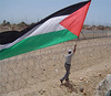 Abdullah flies the flag by the apartheid fence  26 05 06