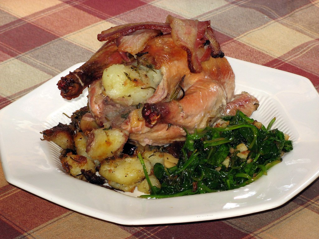Roasted Game Hens wrapped in bacon and stuffed with potatoes, rosemary, and thyme