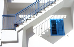 shadow games on a white house with blue accents (Amelia PS) Tags: blue light shadow italy white window architecture stairs poetry mediterranean mediterraneo italia poem shadows shades tagore ameliaps