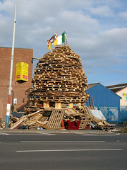 12th Night Bonfire, North Belfast (Howard.) Tags: road wood sky yellow belfast 2006 flags northernireland