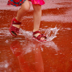 Summer Splash (4mediafactory) Tags: red summer playing wet water rain topv111 kids munich mnchen puddle topv333 shoes dancing topc50 running redspace redrule splash oneyear regen sommerfest redsandals neuhausen pftze newphotographers top20red