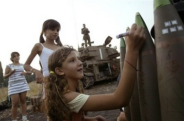 writing a letter with a smile and parent's approval Lebanon bombing 2006, AP photo