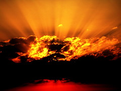 On Fire (Ana Bel) Tags: sunset red sky orange sun yellow clouds fire gold switzerland rays instantfaves