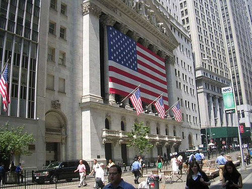 The facade of the New York Stock Exhange draped in the U.S. flag