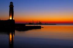 D2X_5994 Magical sunrise at Rthymno (Vilhelm Sjostrom) Tags: lighthouse silhouette sunrise geotagged boat lenstagged interestingness nikon flickr mediterranean ship top20sunrisesunset horizon d2x explore 500v50f crete top20hallfame nikkor 1735mmf28d reflexions freighter top20halloffame rethymno rethymnon top20horizonpix mustavalkoinen cotcmostfavorited venetianharbour interestingness34 i500 top20colorpix nikonstunninggallery top20lh rthymno venetianharbor rhethymno retymno ysplix cvilhelmsjstrm wwwmustavalkoinenfi