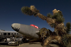 Joshua says GO! (Lost America) Tags: lightpainting night airplane joshuatree fullmoon junkyard boneyard airliner startrails aviationwarehouse