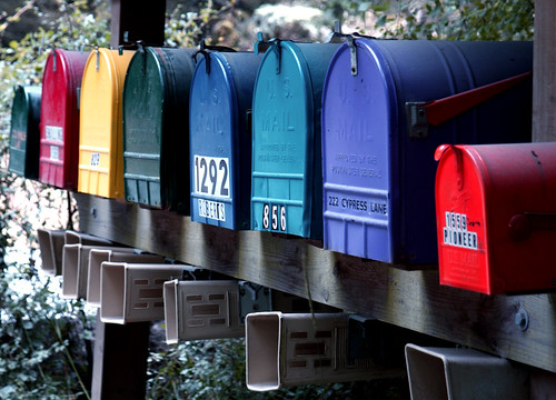 colorful residential mailboxes painted in brilliant alternating colors