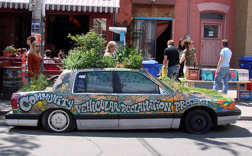 This car, in Toronto's Kensington Market, is a real planter with plants growing in it and on it!