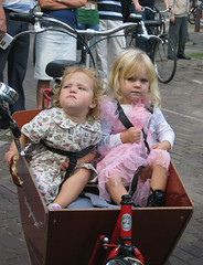 Kids in a bike basket (abragrace) Tags: pink girls holland netherlands amsterdam bike kids children canal europe transportation tulle grachtenfestival