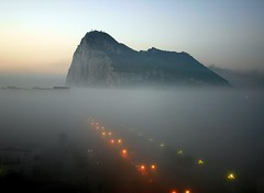 The Rock in Fog (Henriette88) Tags: light red rock misty fog island moody crossing tail border foggy floating henriette dreamy flush gibraltar frontier linea taillight rythm rockofgibraltar homewardbound lalinea queueing therockofgibraltar 2for2 abigfave carqueue fiveflickrfavs