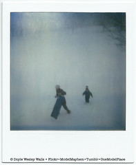 Mother and Child, Sledding (Doyle Wesley Walls) Tags: trees winter light woman snow nature fun polaroid child play hill mother son running photograph sledding activity sled slope winterclothes lagniappe doylewesleywalls