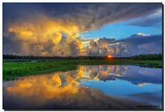 Storm Clouds & Sunrise (Fraggle Red) Tags: morning sun storm nature clouds sunrise reflections landscape florida wetlands thunderstorm hdr stormclouds boyntonbeach 7exp calmmorning greencay greencaywetlands canonef1635mmf28liiusm dphdr palmbeachco canoneos5dmarkiii 5d3 5diii