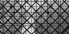 melbourne-2272-ps-w (pw-pix) Tags: buildings towers skyscrapers tall city glass pattern patterned angled grid truss supports geometry geometric triangles squares diamonds translucent transparent ir infrared bw blackandwhite irmodifiednikon1v1 720nminfrared lookingup vertical sky clouds cloudy overcast grey dull cool collinstower anztower collinsplace collinsstreet parisendofcollinsstreet cbd melbourne victoria australia