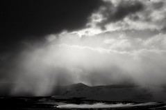 Light brings hope... (Alvin Harp) Tags: february 2014 sonynex5r wyoming winterstorm lightrays stormclouds stormy monochrome mono bwwinter bw alvinharp mountains