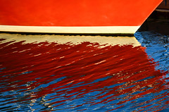 Reflect (James_D_Images) Tags: boat hull red white frontlit reflection water ripples abstract bright colour blue dock