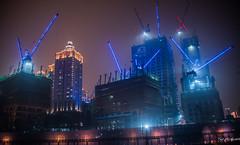2016 - China - Chongqing -  Night Work (Ted's photos - For Me & You) Tags: 2016 china chongqing cropped nikon nikond750 nikonfx tedmcgrath tedsphotos vignetting constructioncranes chongqingchina cranes nightscene nightlighting buildings
