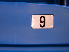 9 - Personal Photography Number Sequence (Jae at Wits End) Tags: blue abstract sports metal america silver bench symbol kentucky interior label seat 9 plate indoor location minimal arena number bluesilver southern american figure inside bleachers minimalism simple gym paducah numerals