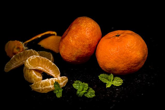 food orange color green beautiful closeup fruit healthy mint indoor fresh mandarin oranges