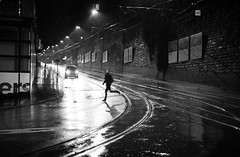 rainy.. (Cem Bayir) Tags: street leica blackandwhite bw rain night 50mm lights schweiz switzerland f14 central grain running rainy zürich summilux asph zh asperical leicam240