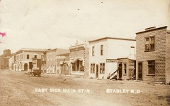 East Side of Main Street, Stanley, North Dakota, USA  - Circa 1910 (Aussie~mobs) Tags: building facade company v stanley streetpool northdakotausaamericawild weststreetscapemain hallshopsm chapinland