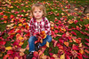 Fall Fun (Jill Clardy) Tags: caitlin rose december 2016 redwood city autumn fall park leaves leaf 201612044b4a8962 fun red orange yellow trees lawn toddler plaid shirt blue jeans sitting explore explored