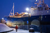 A walk in the harbor (BasLoo) Tags: walk walking harbour port ship snow blue hour night tromsø tromso norway scandinavia pole lens flair street light orange jacket canon eos 450d tamron 18270mm f3563 di ii vc pzd boat harbor haven