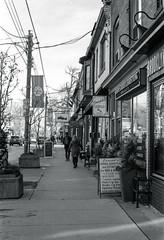 South Side of Queen St. in Leslieville_ (Bill Smith1) Tags: believeinfilm billsmithsphotography december2016 hc110b heyfsc leslieville nikkoraf50f18lens nikonn90s rolleiretro400s toronto