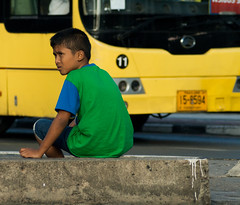 pigeon boy (zestydill) Tags: thailand thai pigeon boy kid yellow grean blue color sitting chasing pigeons bus portrait background foreground