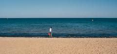 Red Bucket (tarkyn.watt) Tags: boy red sky colour beach water walking bucket sand fujifilm xe1
