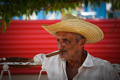 Smoking in the shade (Lil [Kristen Elsby]) Tags: travel portrait candid topv1111 cuba streetphotography streetlife cigar editorial dailylife cuban vinales travelphotography documentaryphotography cubancigar cigarsmoking canon5dmarkii