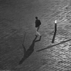 """time flies"" (B.Graulus) Tags: city shadow blackandwhite bw man monochrome leuven canon photography fotografie belgium belgique belgi belgica louvain photografia"