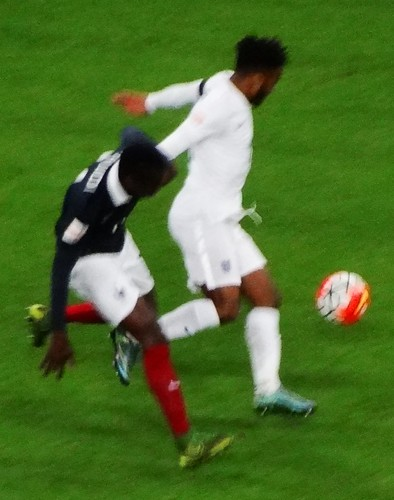 England winger Raheem Sterling clashes with France defender Blaise Matuidi
