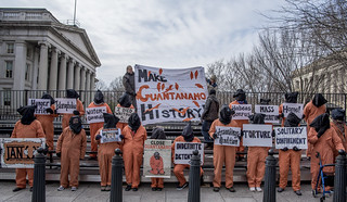 Anti-Torture Protesters Assemble on the Bleachers Set Up for Donald Trump's Inauguration