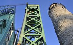Convergence - Burlington Bay Canal Lift Bridge, Hamilton, Ontario (edk7) Tags: nikond300 nikonnikkor18200mm13556gedifafsvrdx edk7 2009 canada ontario hamilton burlingtonbay burlingtonbaycanal burlingtonbaycanalliftbridge publicworksandgovernmentservicescanadapwgsc1962 lakeontario lakeontarioshoreline greatlakes hamiltonharbour industrial trade vehiculartraffic towerdrivenverticalliftmoveablestructure span116m verticallift335m historiclighthouse 60fttower dolomitelimestoneblock derelict decommissioned rust boardedup operationsbuilding shiptraffic architecture building oldstructure sky civilengineering shoreline