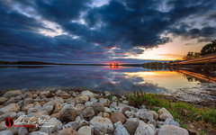 Pewaukee Lake Trail (andrewslaterphoto) Tags: clouds discoverwisconsin lake landscape lighttrail longexposure pewaukee pewaukeelake pewaukeewi place rocks sunset travelwisconsin twilight water waukesha wisconsin andrewslaterphotography landscapephotography canon 5dmarkiii unitedstates us