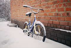 Vovka's bike in snow (Andrey Timofeev) Tags: canon ae1 program fd 50mm 50 18 agfa vista plus 200 iso processbefore201808 december2016 c41 35mm 35мм плёнка manual focus analog russia photography фотография color negative film grain зерно brick wall кирпичная стена bicycle bike велосипед snow снег winter зима bokeh бокэ childhood детство nostalgia ностальгия village country деревня дача old старый mood настроение atmosphere атмосфера time время vintage винтаж