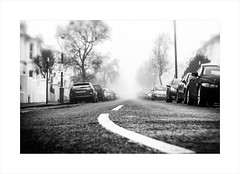 stolen summit (Howard Sandford) Tags: terracedhouses cars leadingline fog road