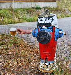 a pint of beer (xtremepeaks) Tags: beer glass draft fire hydrant thirsty funny photoshop ps canada bc bavarian painted street city outdoors