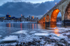 Clouds over Minneapolis (Stone Arch Bridge) (Paul Domsten) Tags: stonearchbridge minneapolis minnesota mississippiriver pentax ice clouds bridge skyline skyscrapers usbankstadium guthrietheater ids wellsfargo goldmedalflour river downtown longexposure water dusk lowlight mill city museum millcitymuseum