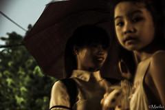 Hanoi (Manlio'77) Tags: portrait people baby cute girl rain umbrella children child mother streetphotography vietnam mum monsoon portraiture hanoi sweetness tenderness northvietnam manliophotography manliodepasquale