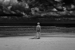 """Subject to..."" (helmet13) Tags: she sky bw woman storm beach silhouette clouds raw waves indianocean fabric silence simplicity tropical seychelles aoi ild 200faves peaceaward heartaward world100f d800e"