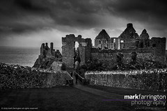 Dunluce Castle Ruins B&W (Mark R Farrington) Tags: uk sea blackandwhite bw castle monochrome rain architecture contrast canon photography eos coast ruins europe unitedkingdom britain cliffs 7d northernireland ulster countyantrim dunluce dunlucecastle desc2012